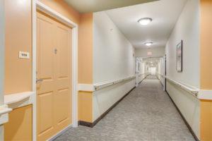long hallway with orange door