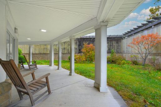 outdoor area with chairs and grass